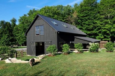 Grey barn tucked in hillside