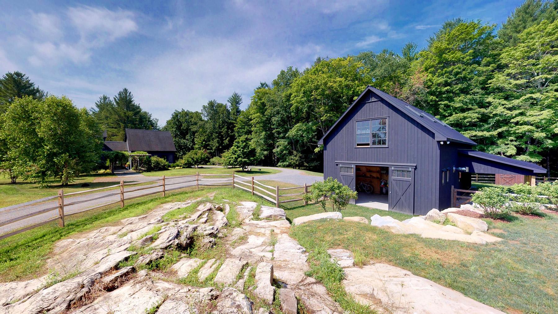 Barn setting in rocky hillside